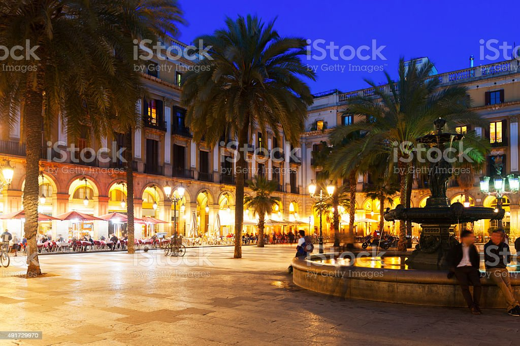 Placa Reial with fountain and restaurants in evening stock photo
