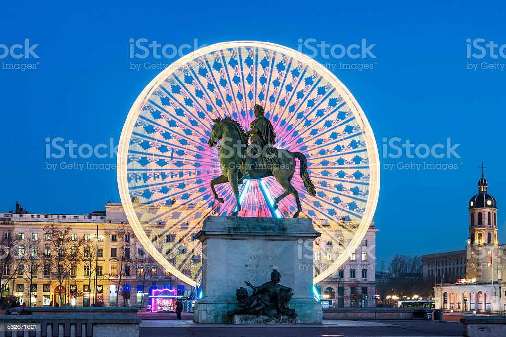 Place Bellecour, famous statue of King Louis XIV by night stock photo