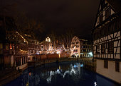 Place Benjamin Zix Christmas market stalls reflected in Ill river
