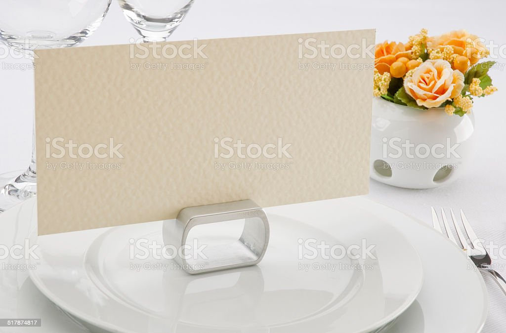 Place card on the white festive table stock photo