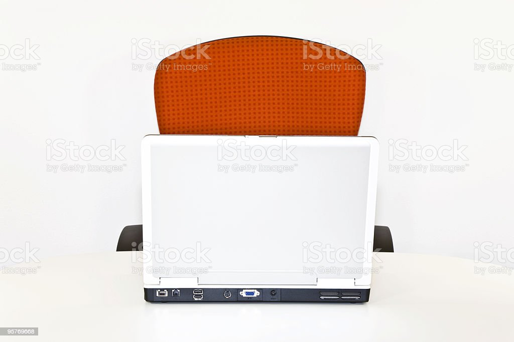 Place of Work With Orange Chair and Laptop stock photo