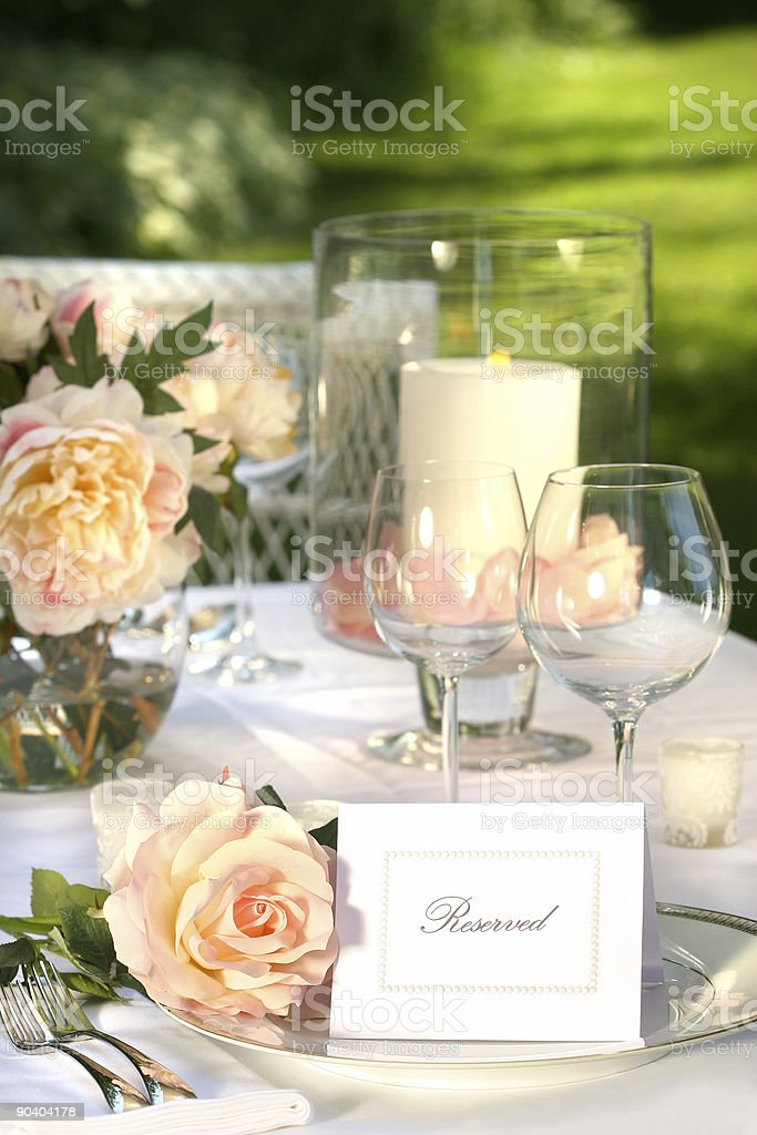 Place setting and card on a table stock photo
