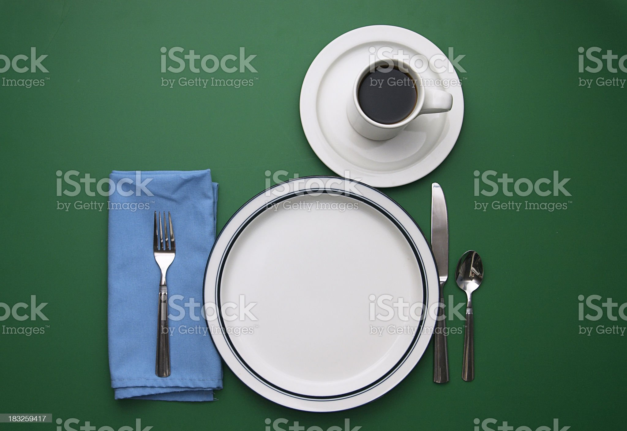 Place Setting on Green with Empty Plate royalty-free stock photo