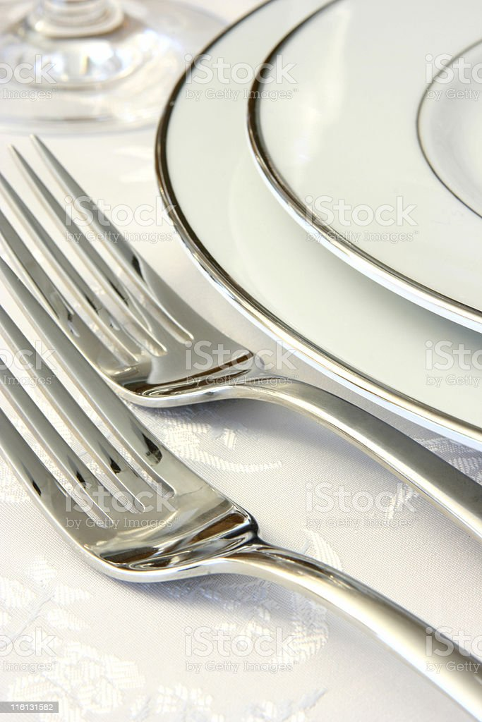 Place Setting White Plates and Silverware Close-up royalty-free stock photo