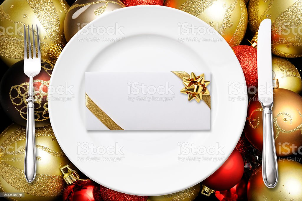 Place setting with blank envelope on colorful Christmas balls stock photo
