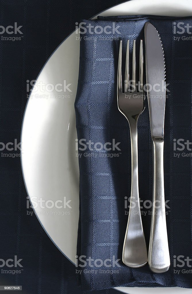 Place Setting with Blue Napkin royalty-free stock photo