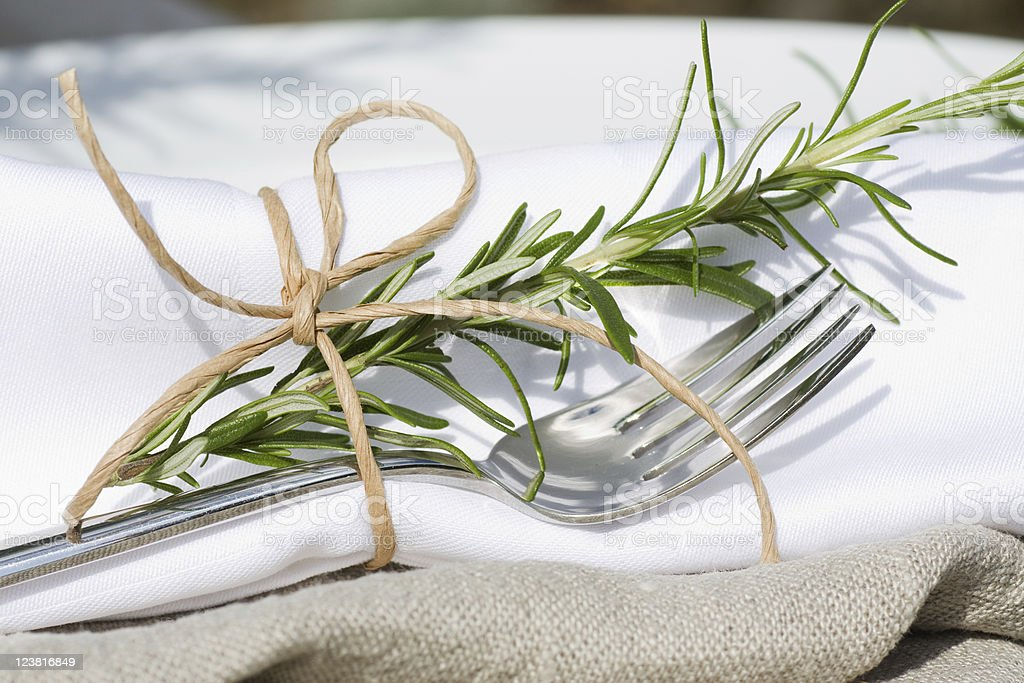 Place setting with fork and rosemary stock photo