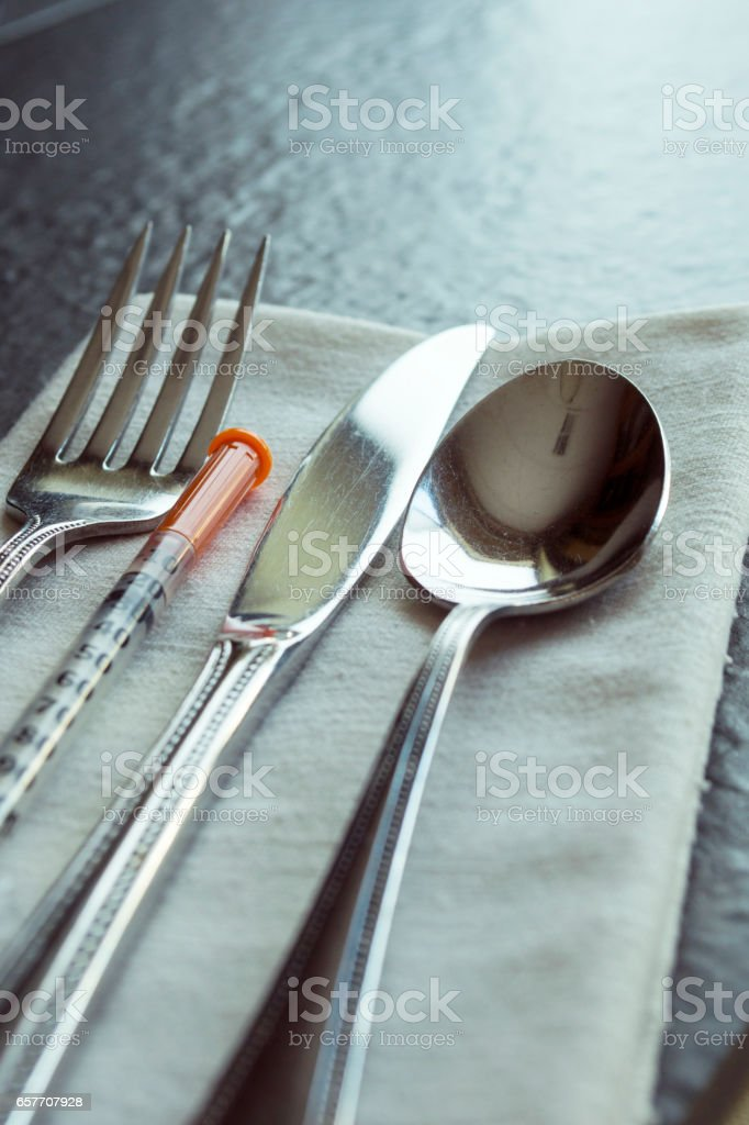 Place setting with Insulin syringe stock photo