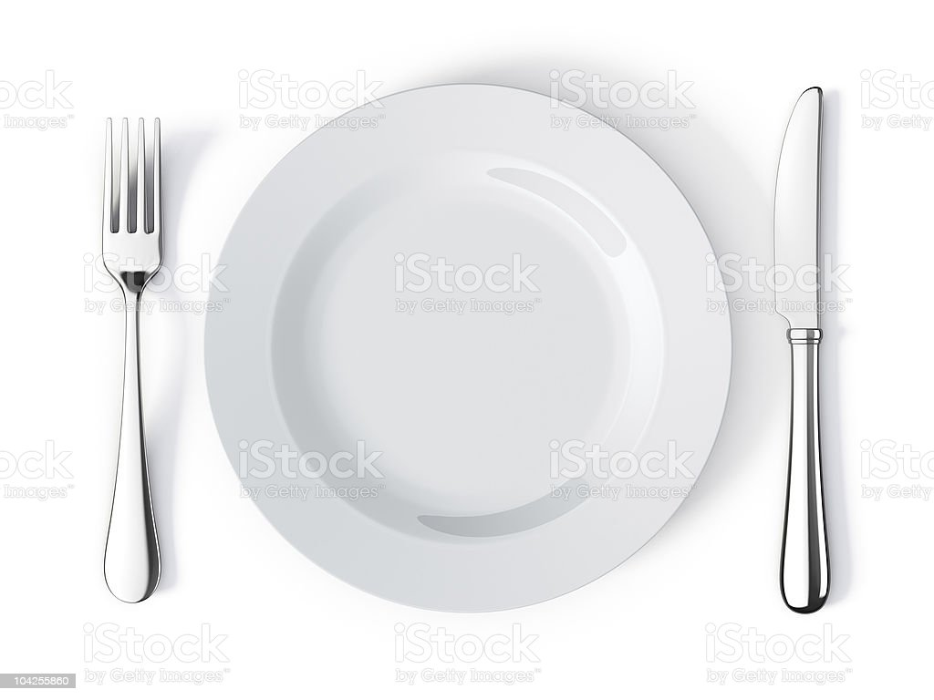 Place setting with plate, knife and fork stock photo