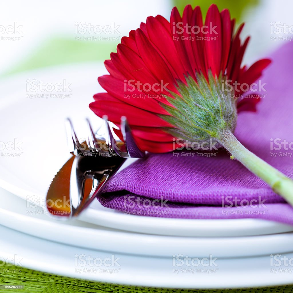 Place setting with red gerbera royalty-free stock photo