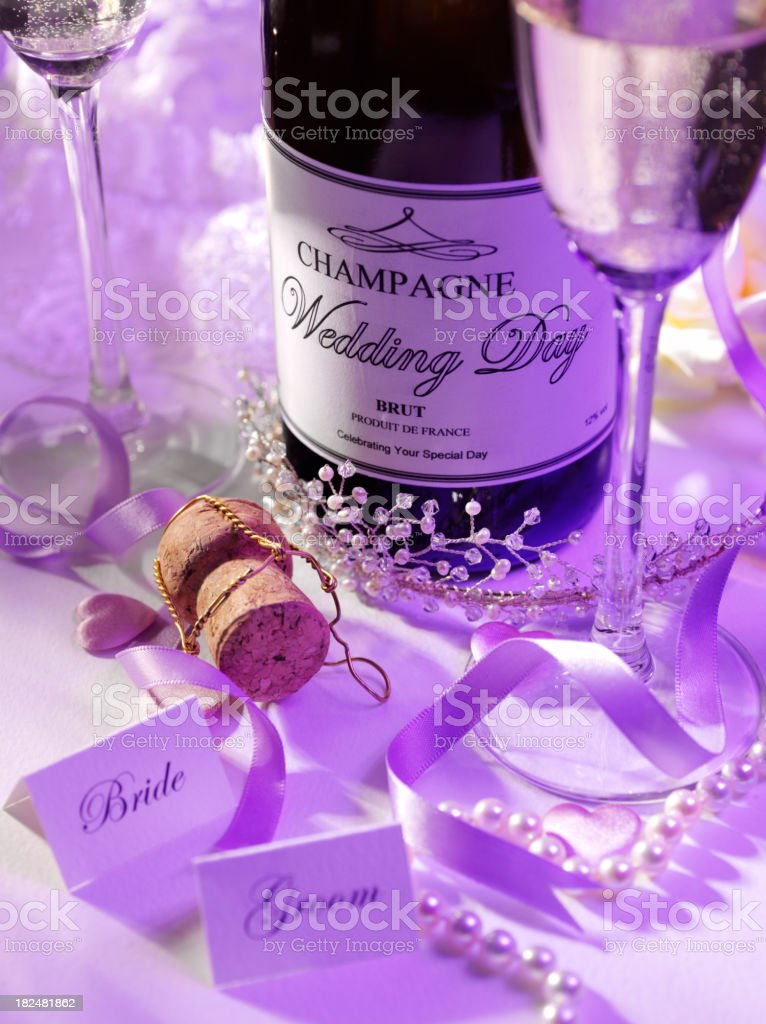Place Settings and a Champagne Bottle royalty-free stock photo