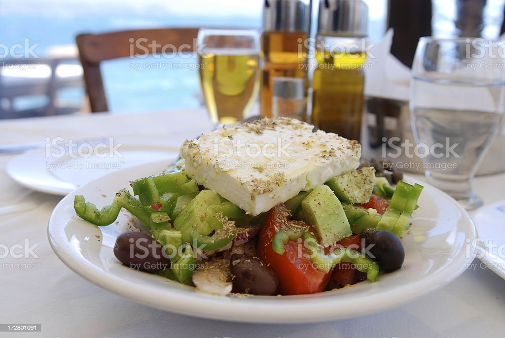 place settings with traditional greek salad and condiments royalty-free stock photo