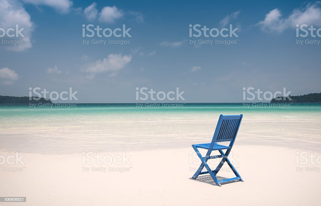 Place to Rest, Chair on a Sandbank in the Ocean stock photo