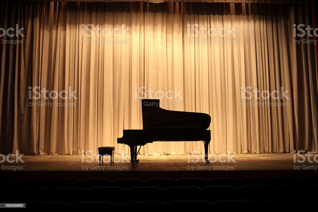 Placed center stage is the grand piano stock photo