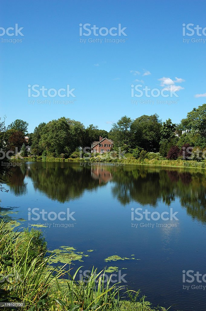 Placid lake scene with home at water's edge royalty-free stock photo