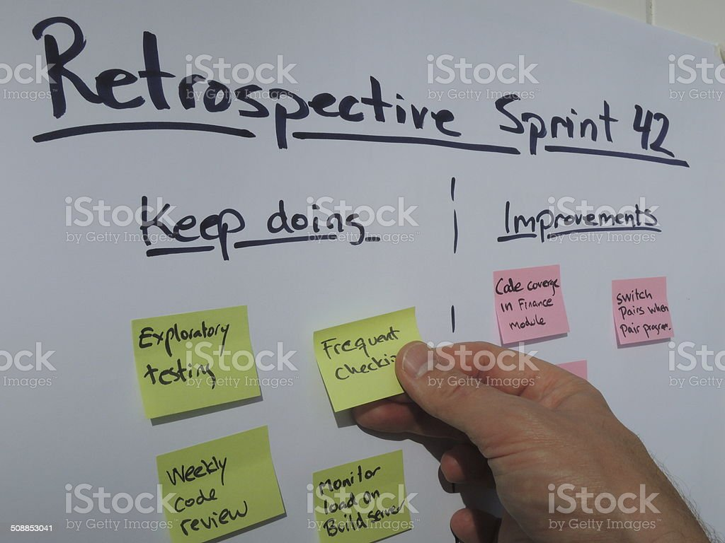 Placing a keep doing note during retrospective meeting stock photo