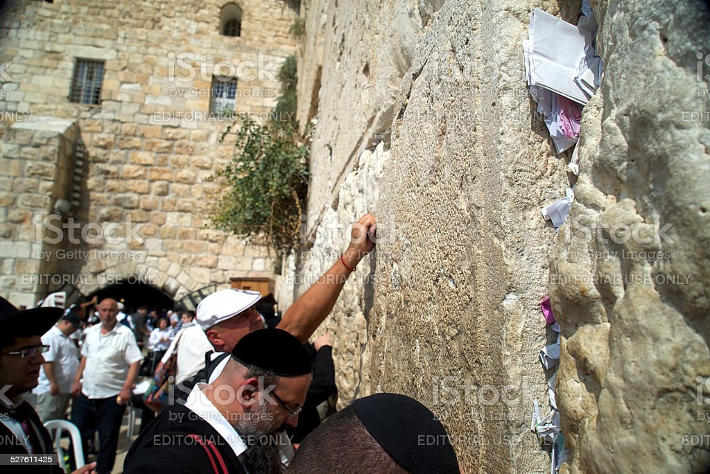 Placing a Note in the Wall stock photo
