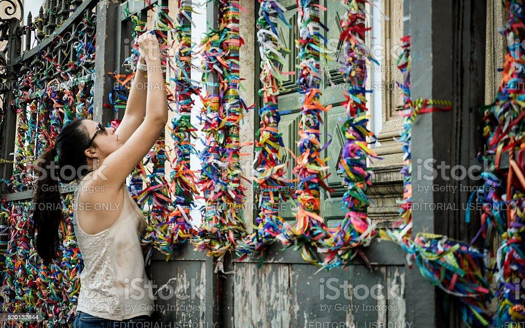 Placing a wish during the Festa do Bonfim, Salvador, Brazil stock photo