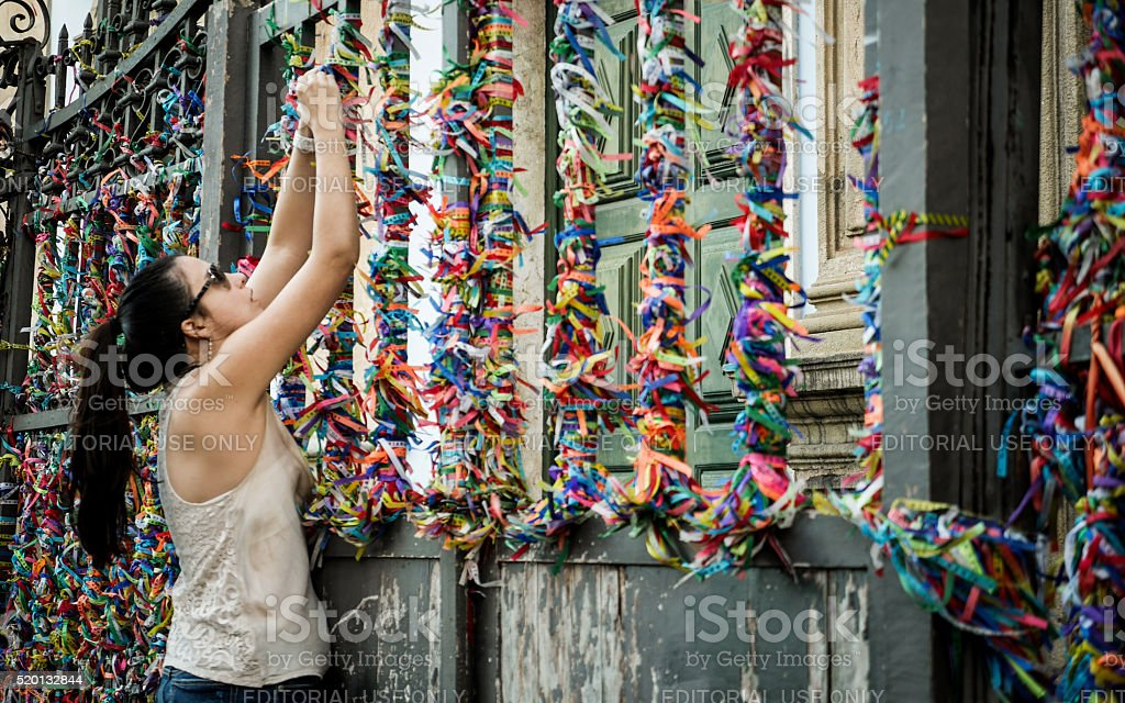 Placing a wish during the Festa do Bonfim, Salvador, Brazil stock photo