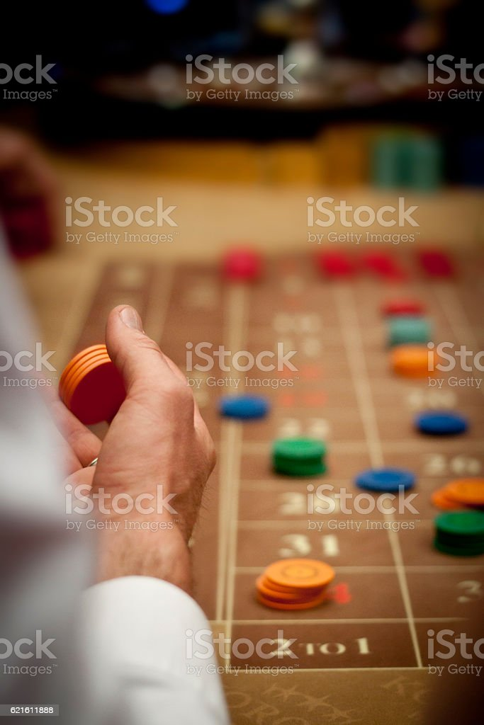 Placing bets on a roulette table stock photo