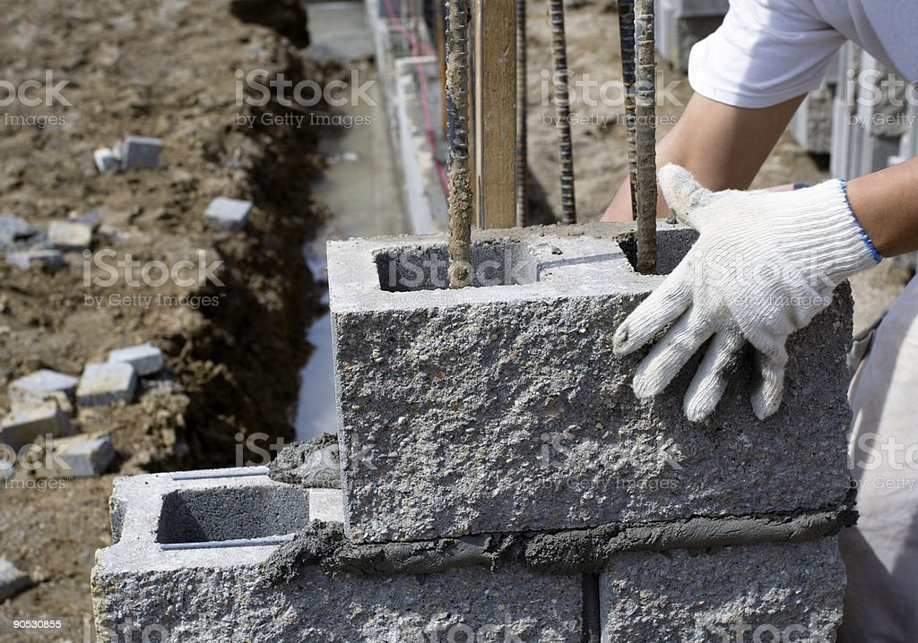 Placing Cinder Blocks stock photo
