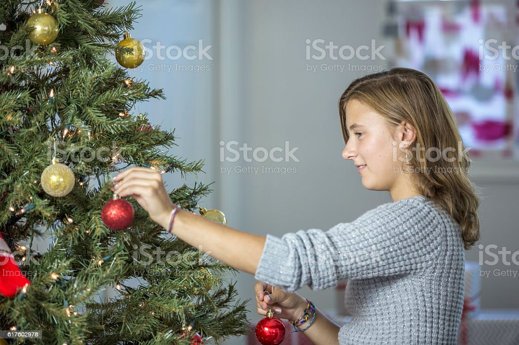 Placing Ornaments on the Tree stock photo