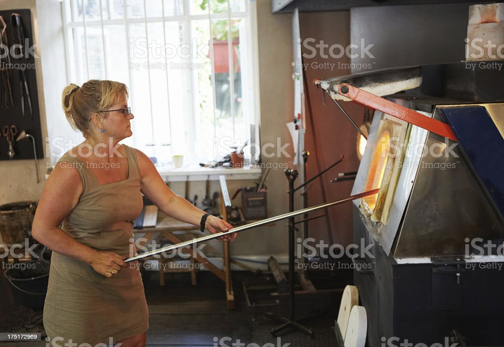 Placing the glass in a furnace royalty-free stock photo