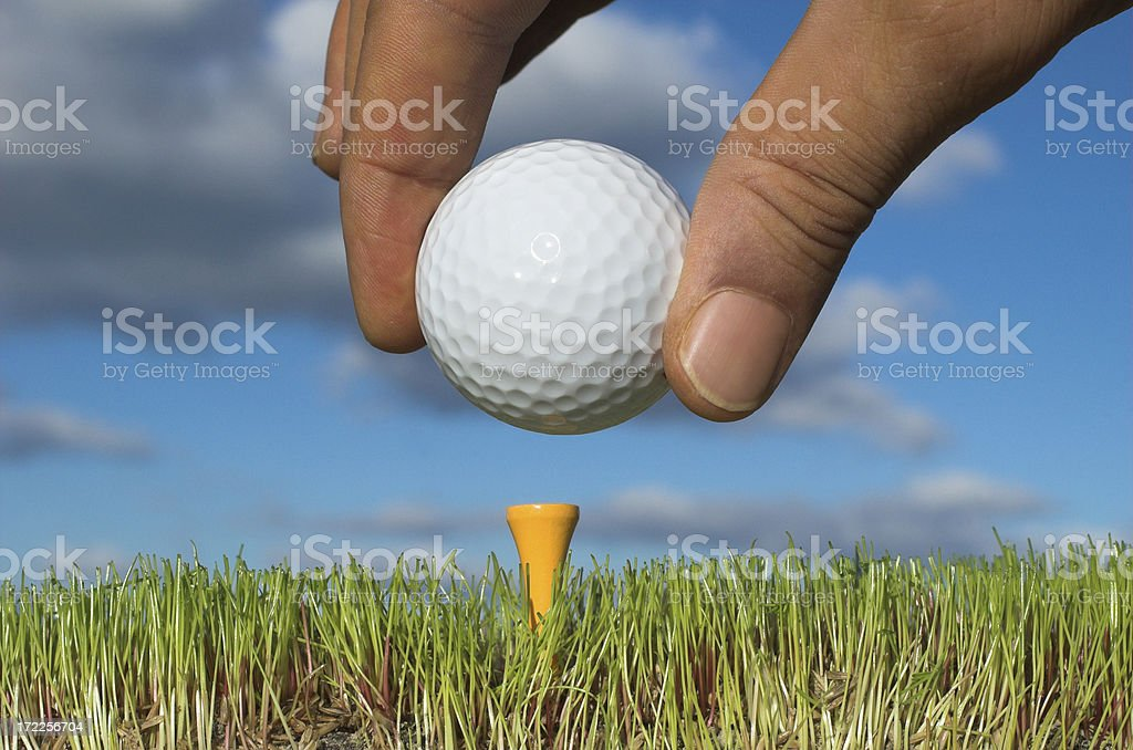 placing the golf ball royalty-free stock photo