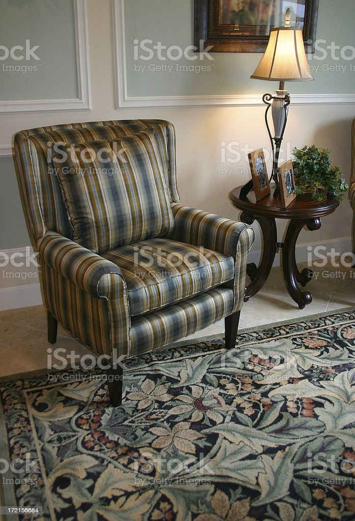Plaid Chair, Flowered Carpet royalty-free stock photo