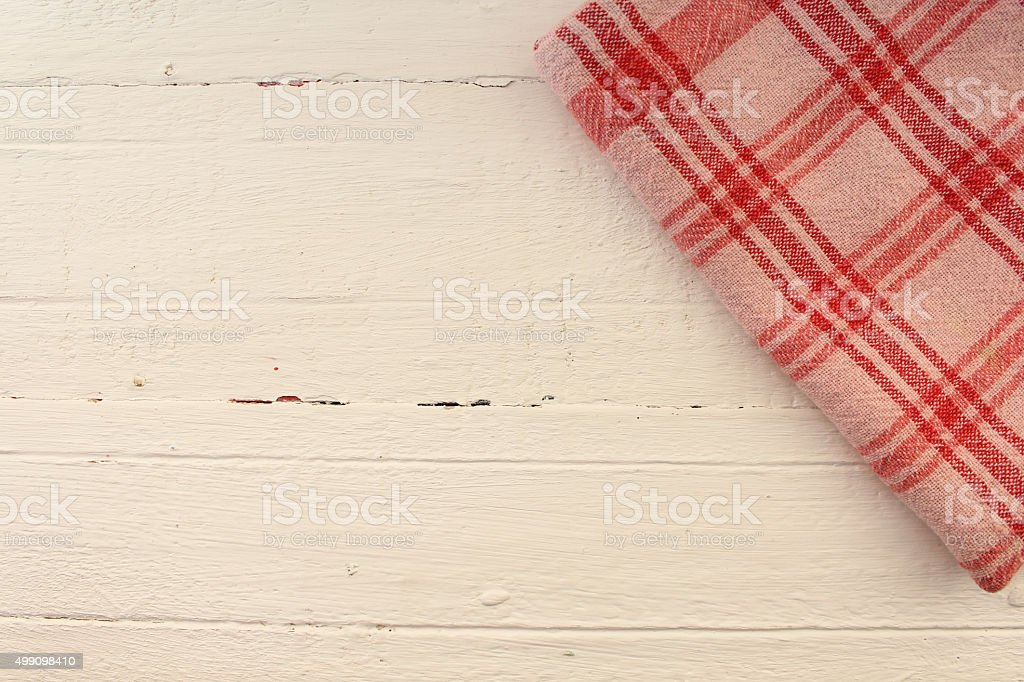 Plaid cloth on table stock photo