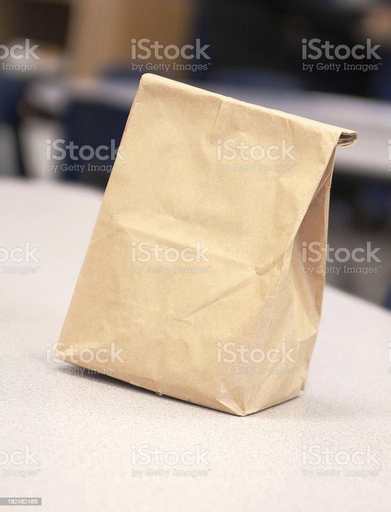 Plain Blank Brown Paper Lunch Bag on a Table stock photo