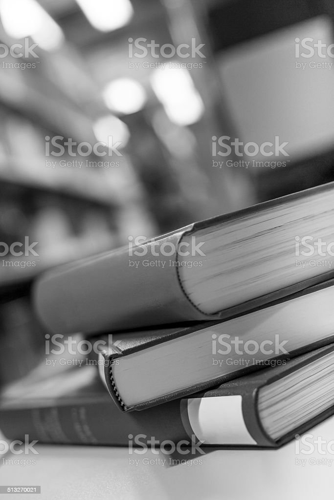 plain books in a library black and white stock photo