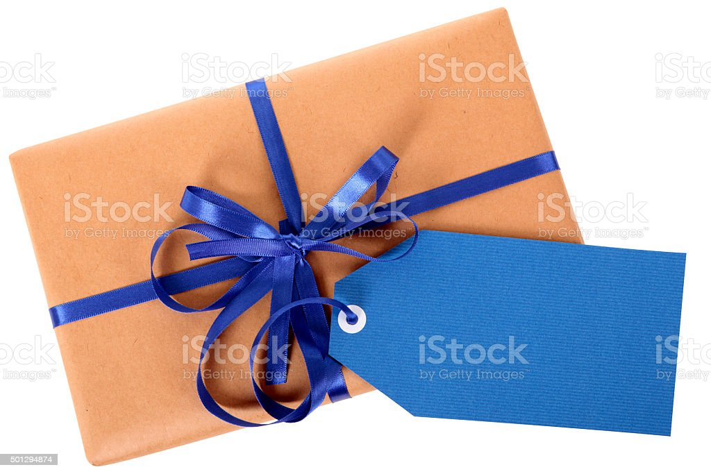 Plain brown paper package or parcel, blue gift tag stock photo
