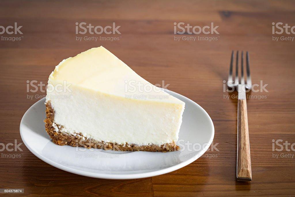 Plain cheesecake on white plate stock photo