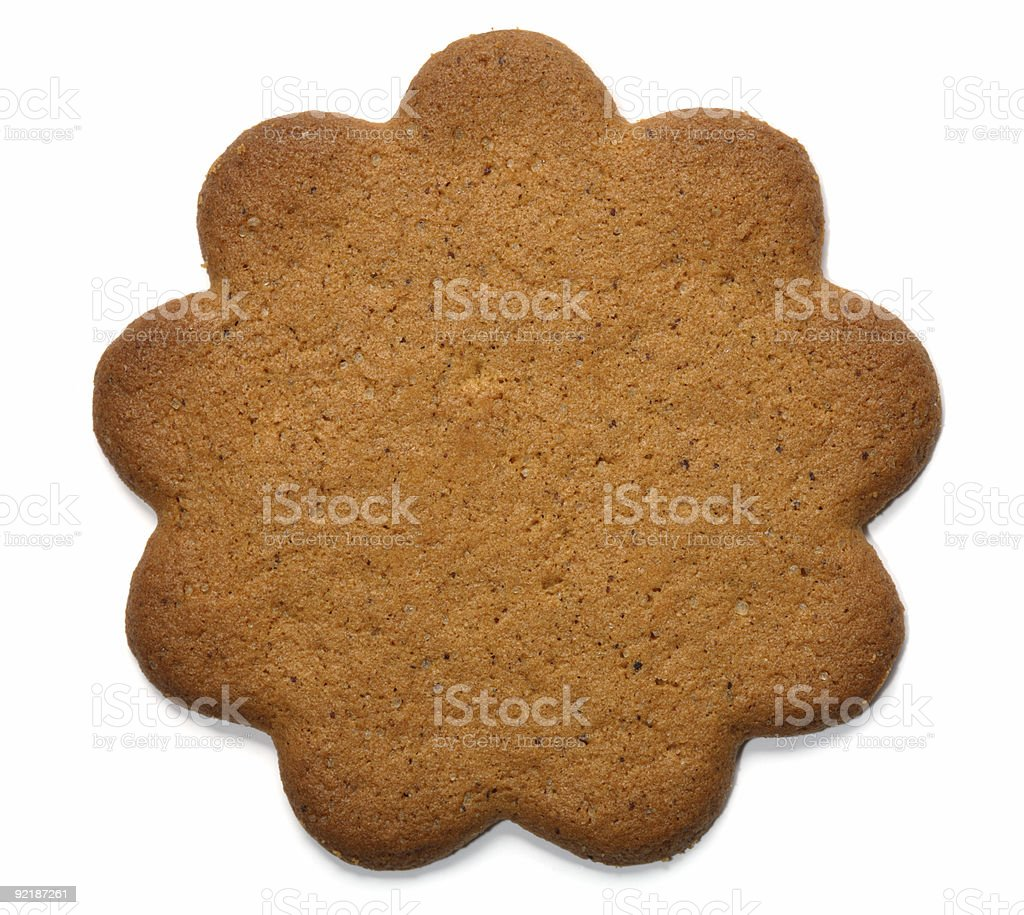 Plain gingerbread cookie with scalloped edge stock photo