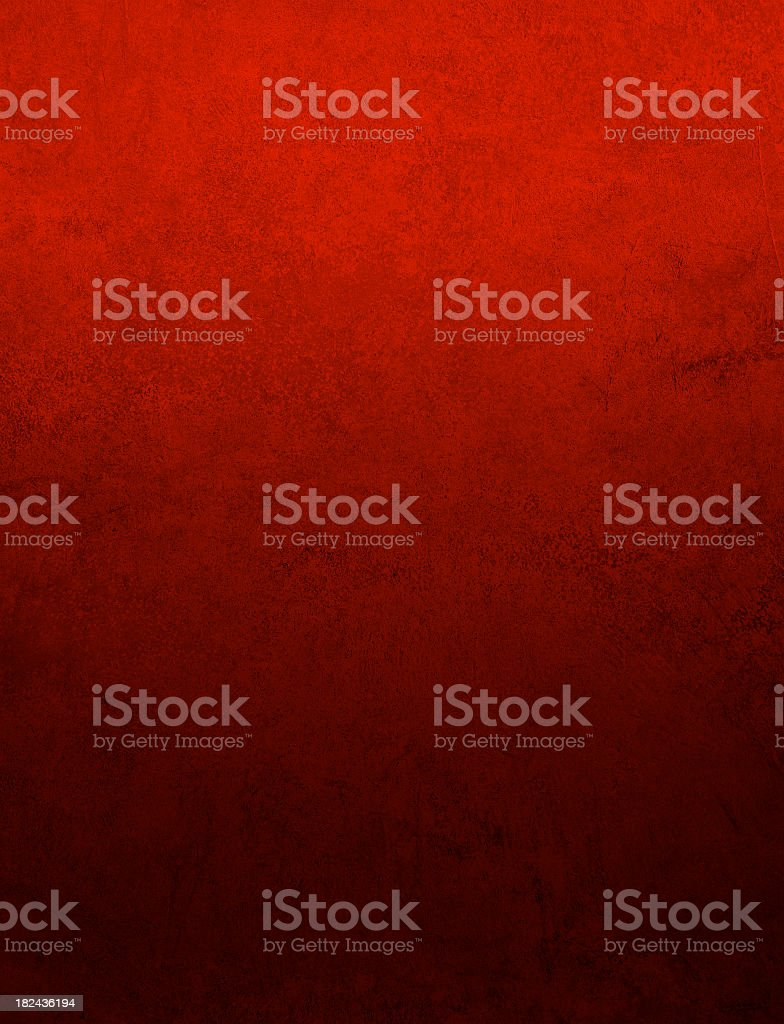 A plain mottled red background stock photo