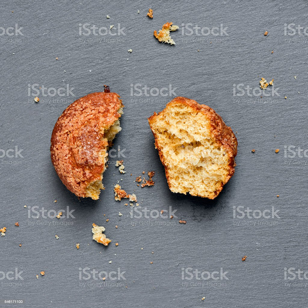 plain muffin on a slate background stock photo