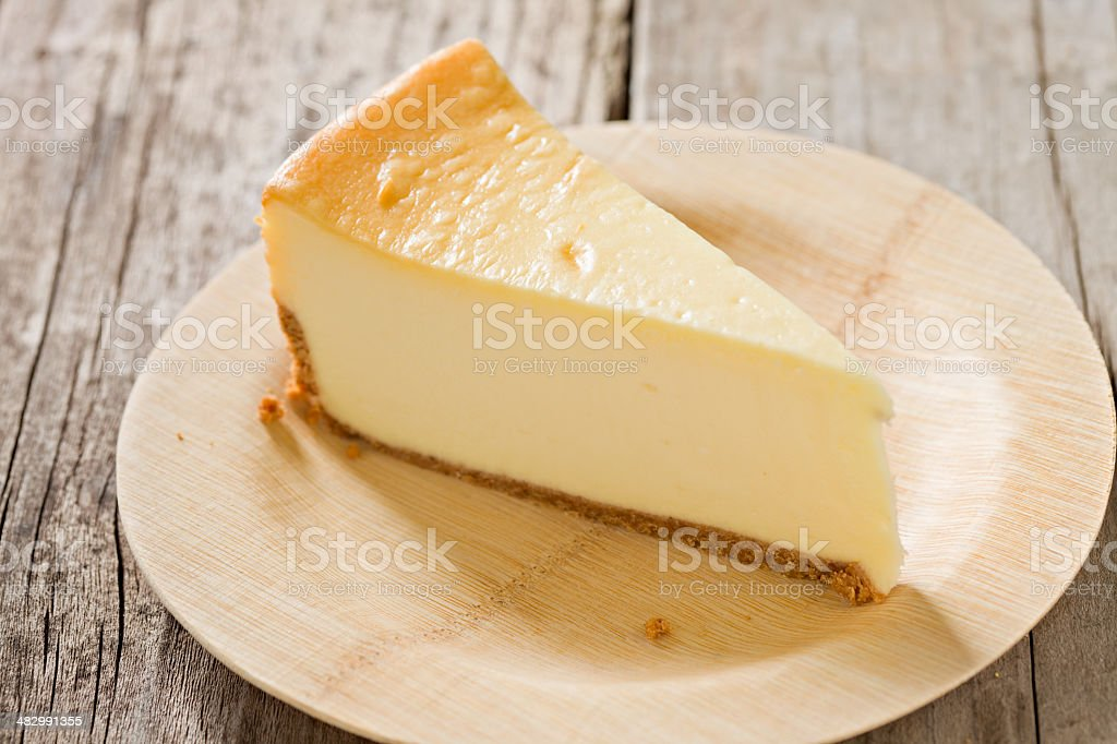 Plain New York Style Cheesecake On A Bamboo Plate stock photo