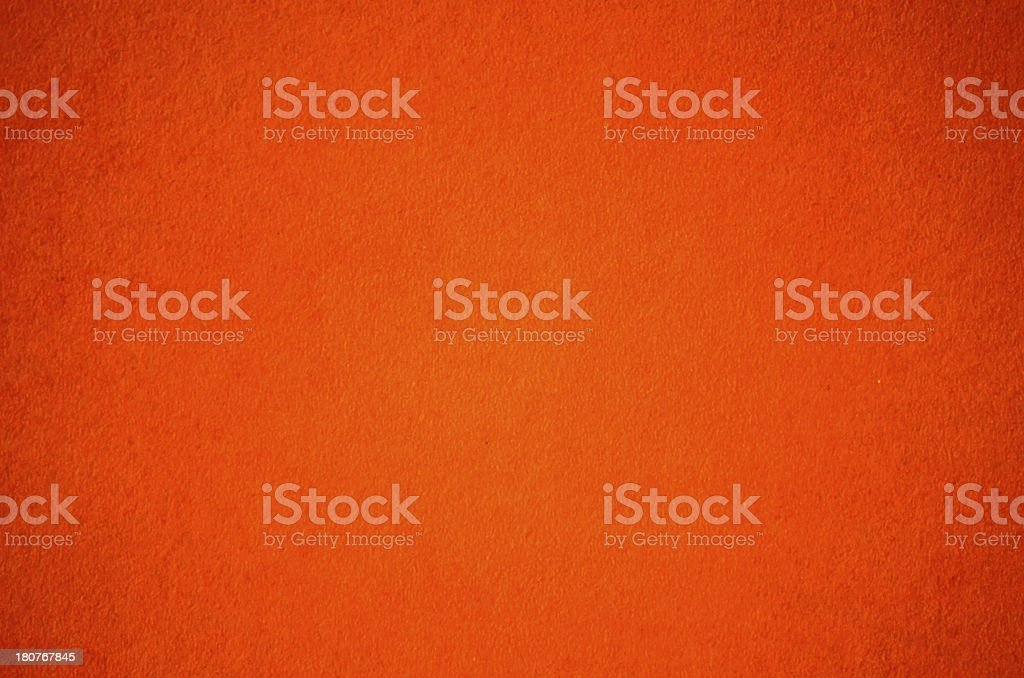 Plain orange background with a slight texture stock photo