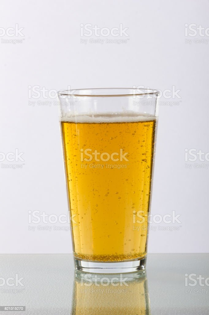 Plain Pint Glass of Beer with Reflection stock photo