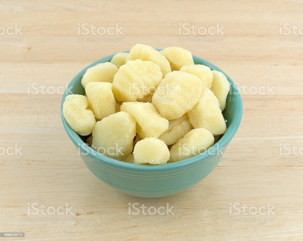 Plain potato gnocchi in a green bowl stock photo