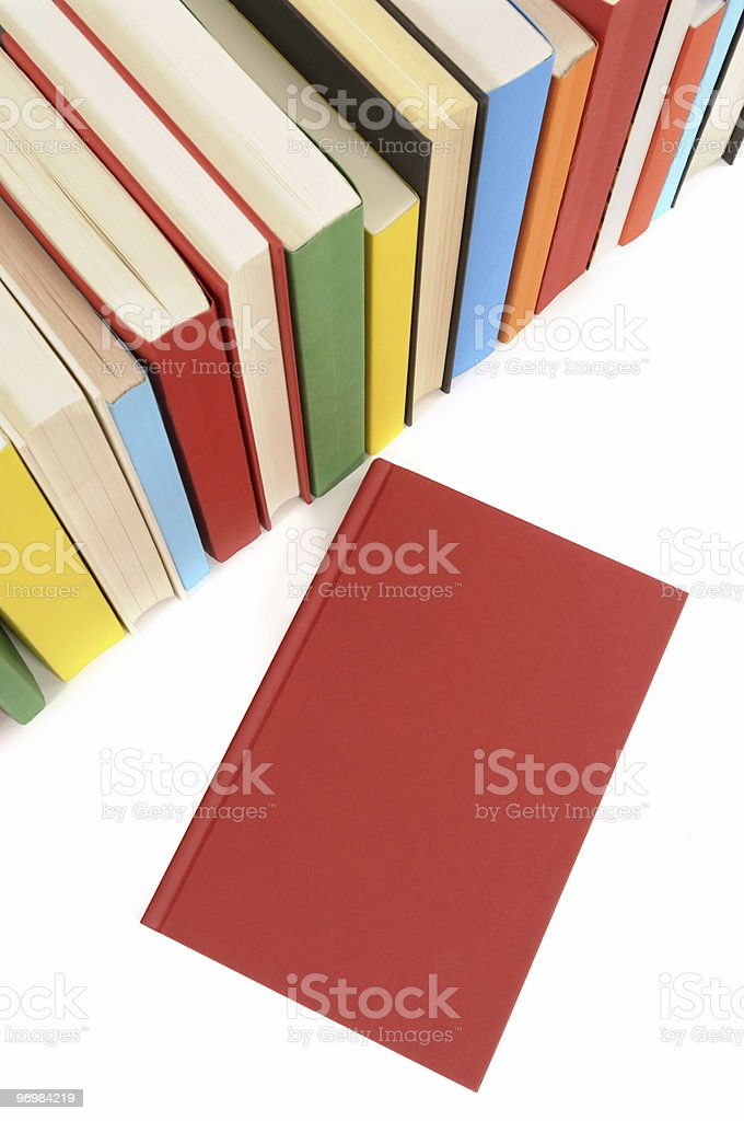 Plain red book with row of colorful books royalty-free stock photo