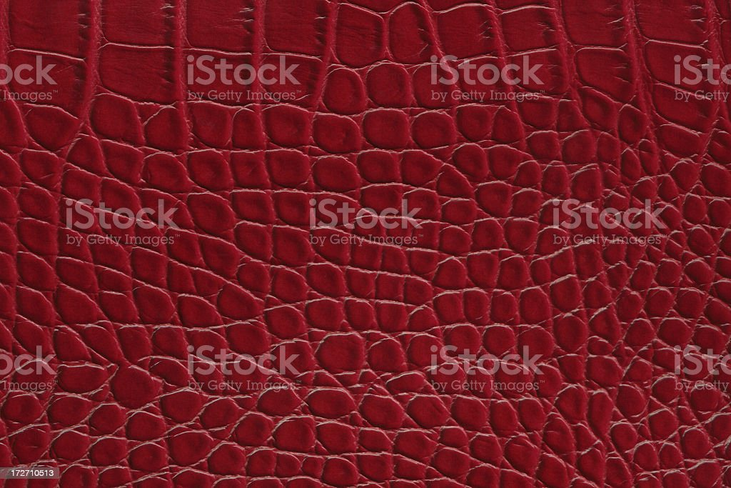 Plain red leather background with scales stock photo