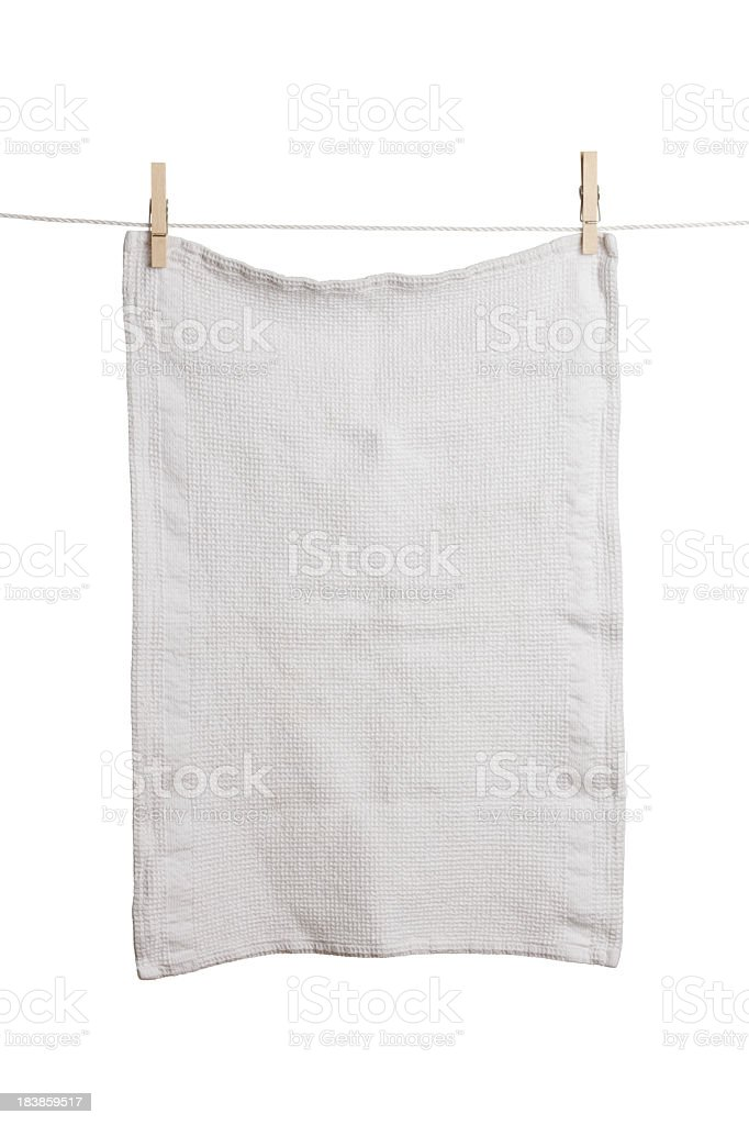 A plain white dish towel hanging on a line stock photo