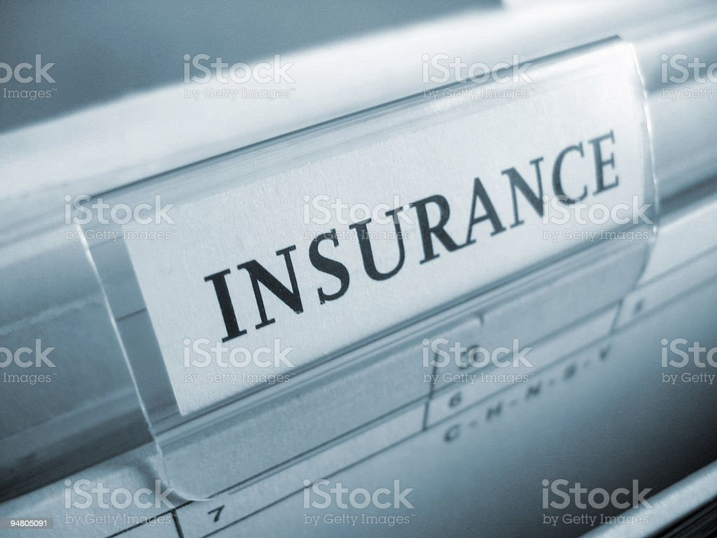 A plain white insurance sign in all caps royalty-free stock photo