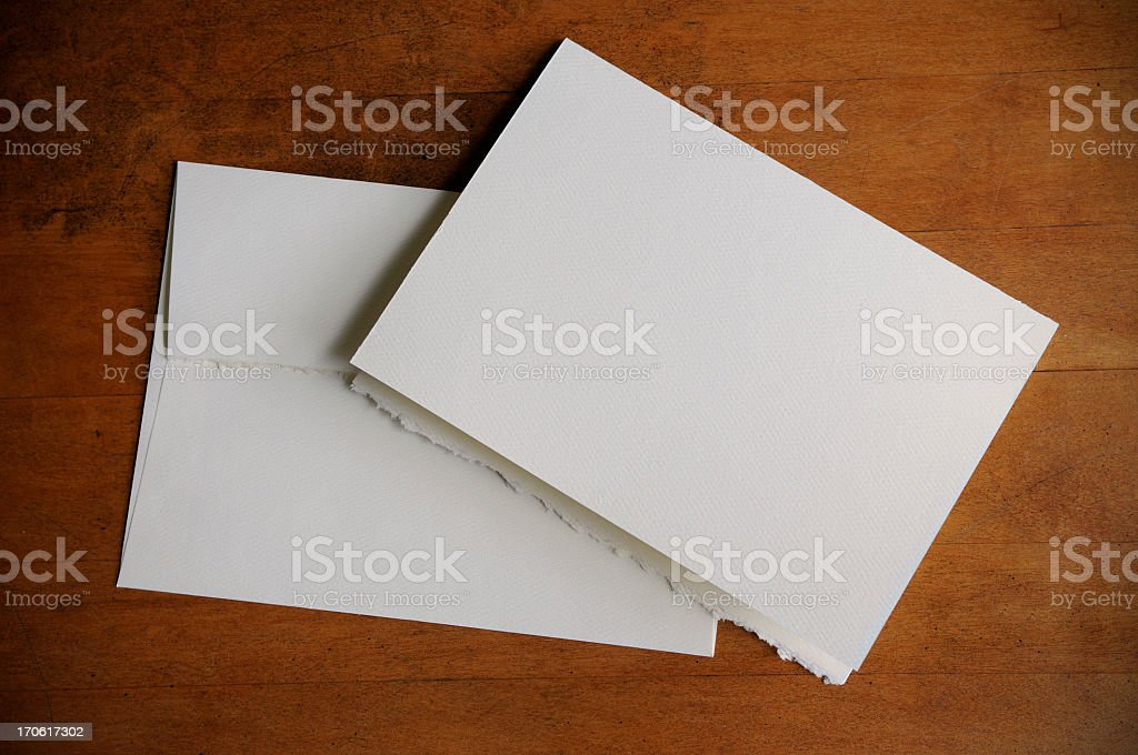 Plain white invitation and envelope stock photo