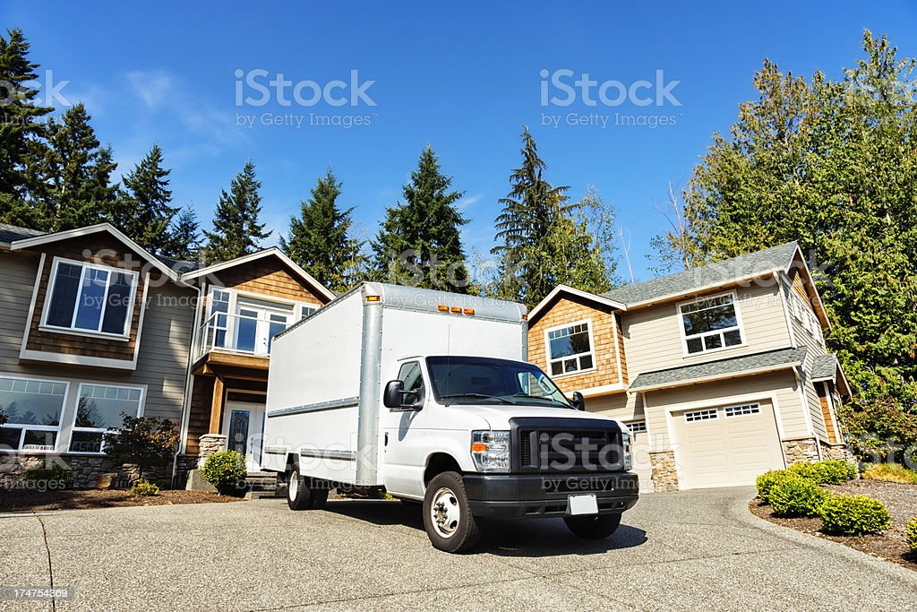 Plain White Moving Truck in Driveway royalty-free stock photo