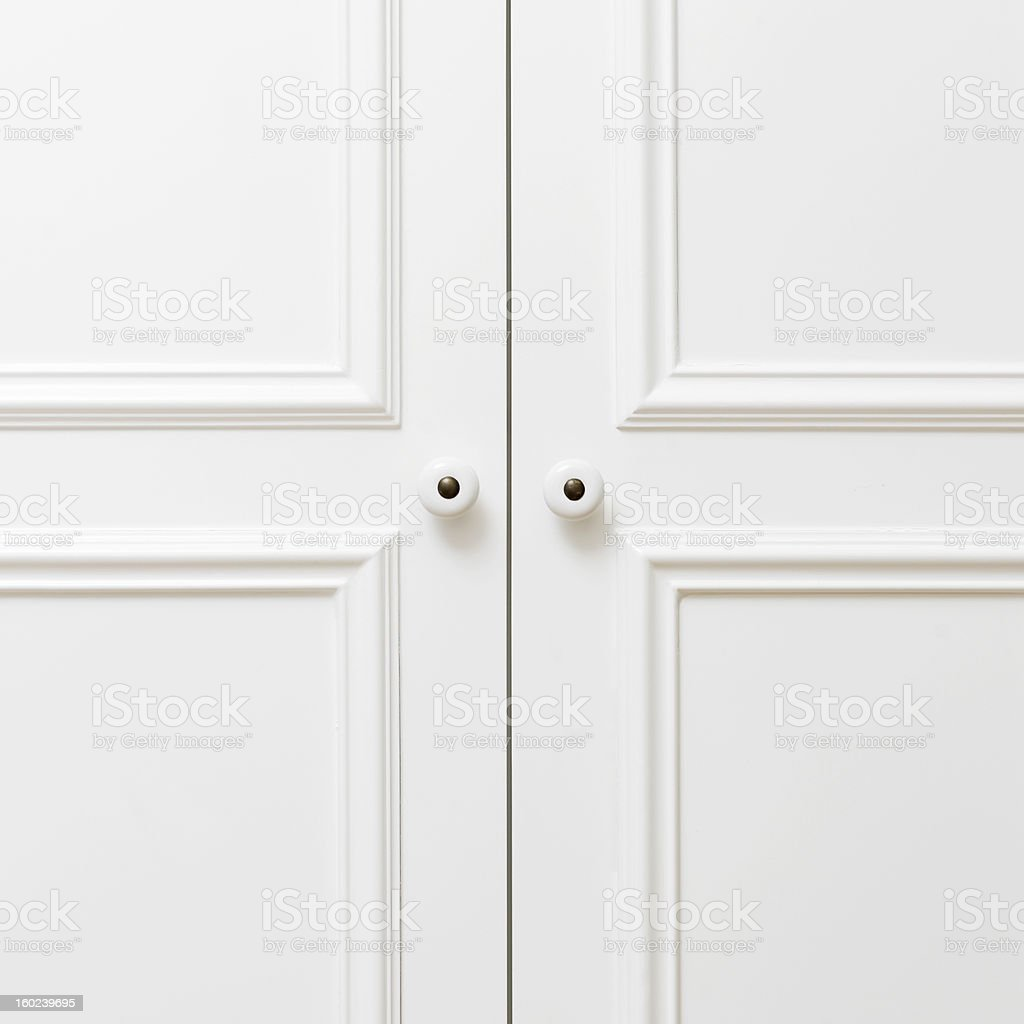 Plain white wooden doors stock photo