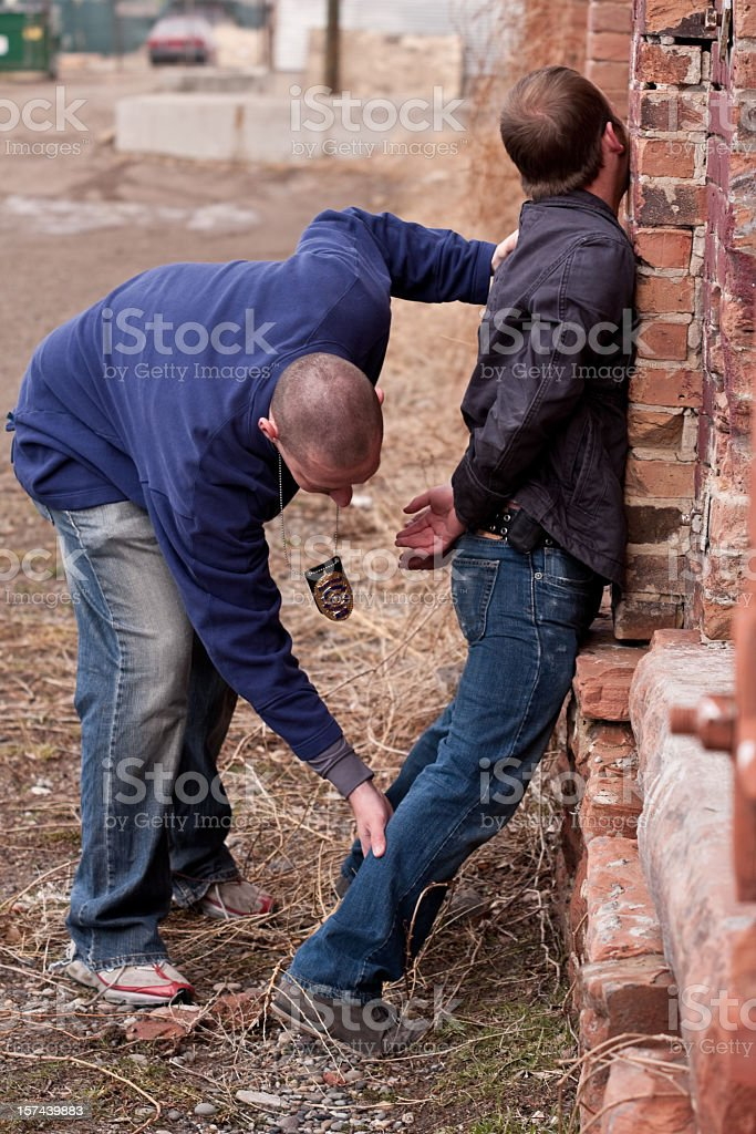 Plainclothes Cop Arresting Young Thug royalty-free stock photo