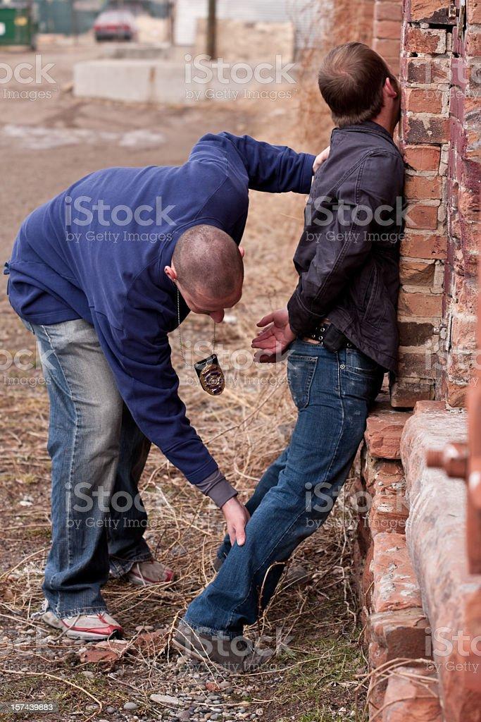 Plainclothes Cop Arresting Young Thug stock photo